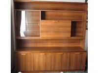 Wall Unit. Teak coloured with glass display cabinet. Good condition.