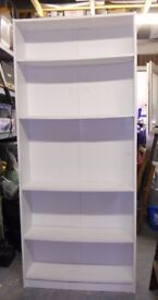 White shelving unit with one fixed and three adjustable shelves