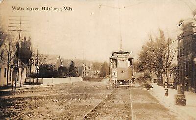 G34/ Hillsboro Wisconsin RPPC Postcard 1913 Water Street Trolley Stores (Hillsboro Stores)