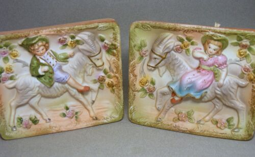 Two Vintage Pottery Wall Plaques Boy and Girl Riding on GOATS