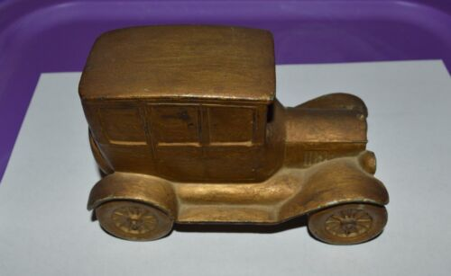 Vintage cast iron coin bank truck