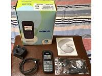 Nokia 1208 mobile phone in perfect condition with box, charger, unused earphones & manual