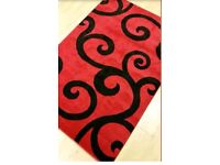 Brand new red and black rug for sale