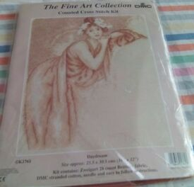 New counted cross stitch kit called Daydream. Picture is of a girl leaning on a couch.