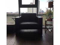 Stylish modernist black leather armchair