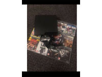 PS3 120GB mint brand new condition no box with 2 controllers, charging cable12 gaes not PS4