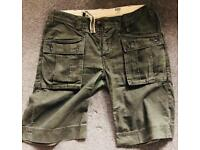 "Levi's men's shorts military style Size 34"" waist."