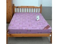 Wooden double bed frame with double mattress