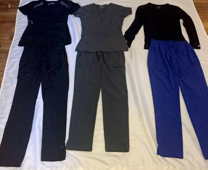Lot of 6 Scrubs. 3 Scrub Star Pants XS/Activate XS & 1 XXS White Cross XXS, D40