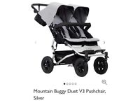 Mountain Buggy Duet (double buggy) including rain cover. Less than 3 months old