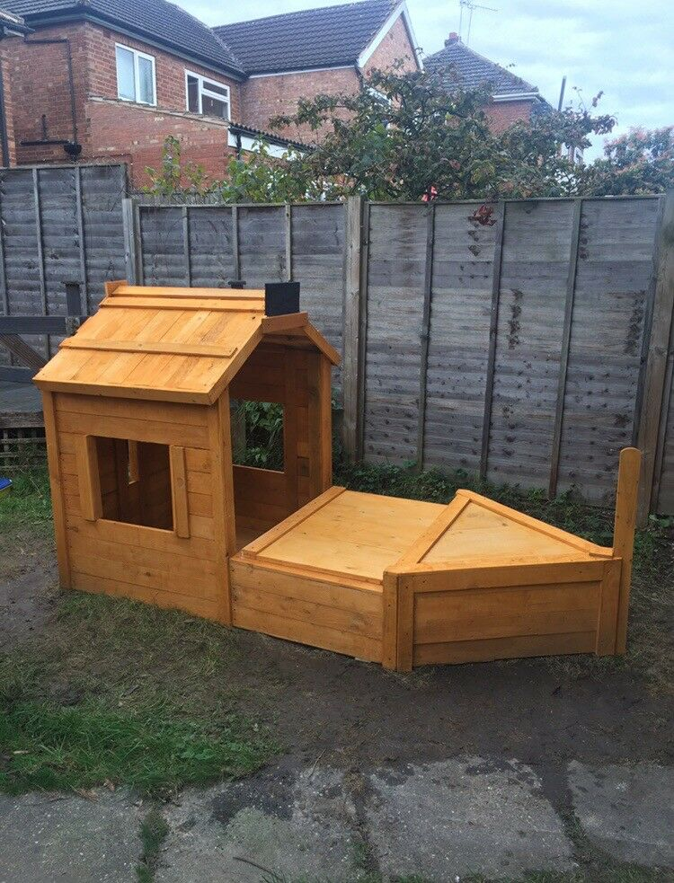 Outdoor wooden pirate ship with sand pit & cover lid