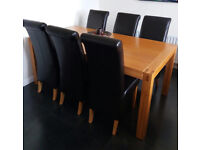 solid oak dining table and 6 leather finish chairs
