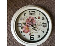 Floral 'silent sweep' wall clock.