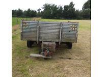 Flat bed four wheel trailer