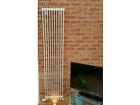 Vertical radiator (cream gloss) used.