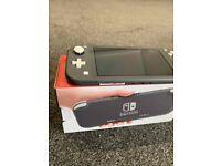 Nintendo Switch Lite in Grey (minor scratch) + Animal Crossing + Pokemon Sword