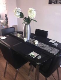 Black and silver glass table and 4 matching chairs