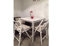 Beautiful white tablet with two chairs