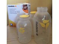 Medela milk bottles large and 3 small