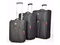 2 new black extralarge suitcases