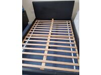 Black leather double bed with clean mattress in excellent condition