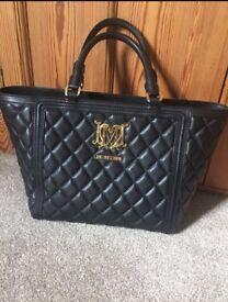 Black quilted Moschino handbag