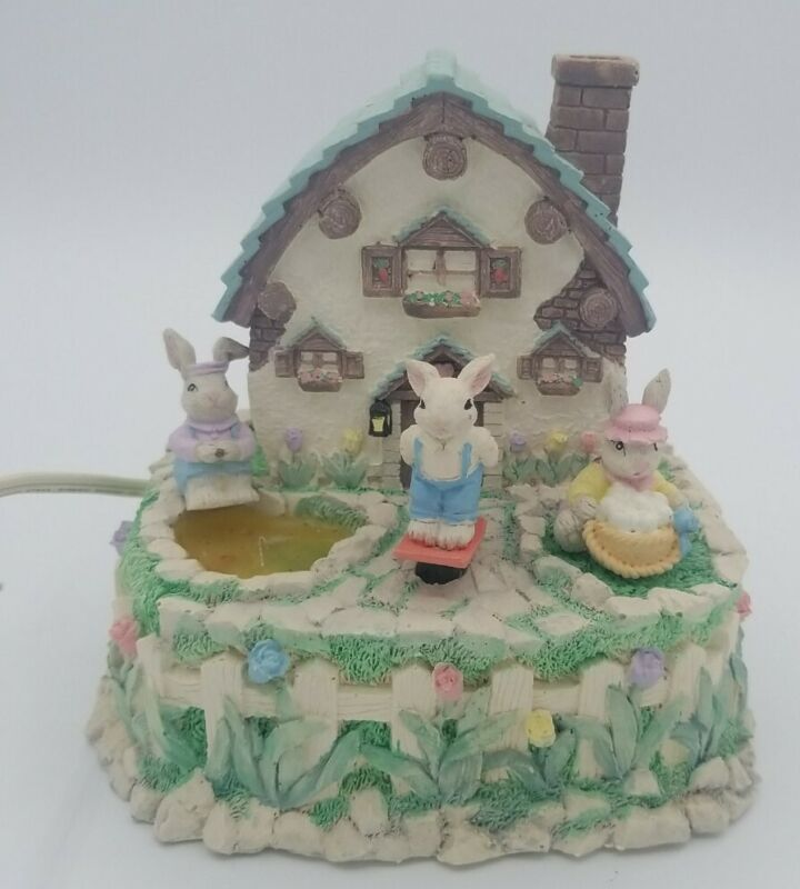 Lighted Animated Music box Easter Cottage w/ Bunnies.