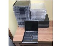 Over 50 brand new CD or DVD cases. Black and clear