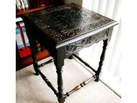 Carved side table in dark finish