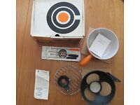 Le Creuset Cheese Fondue Set (pan,stand, burner and forks). Never used. Still in original box.