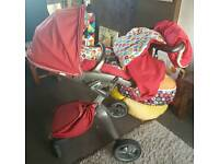 Stokke xplory pushchair in red with extras