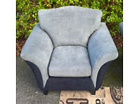 A New Designer Grey and Black Fabric Material Arm Chair.