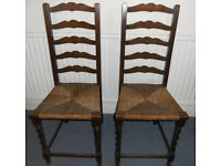 Two Oak Ladder-back Chairs with Rush Seating and Barley Twist Legs