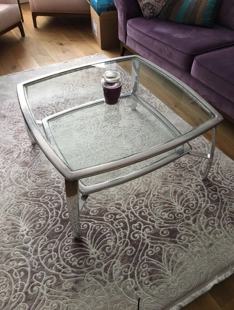 Glass top metal coffee table and two side tables