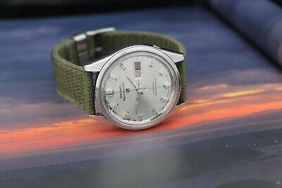 Vintage Seiko Sportsmatic 5 6619 - 9010 December 1965 21 Jewel Automatic watch.