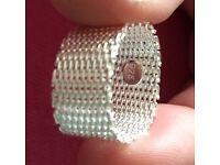 Genuine designer woven silver ring