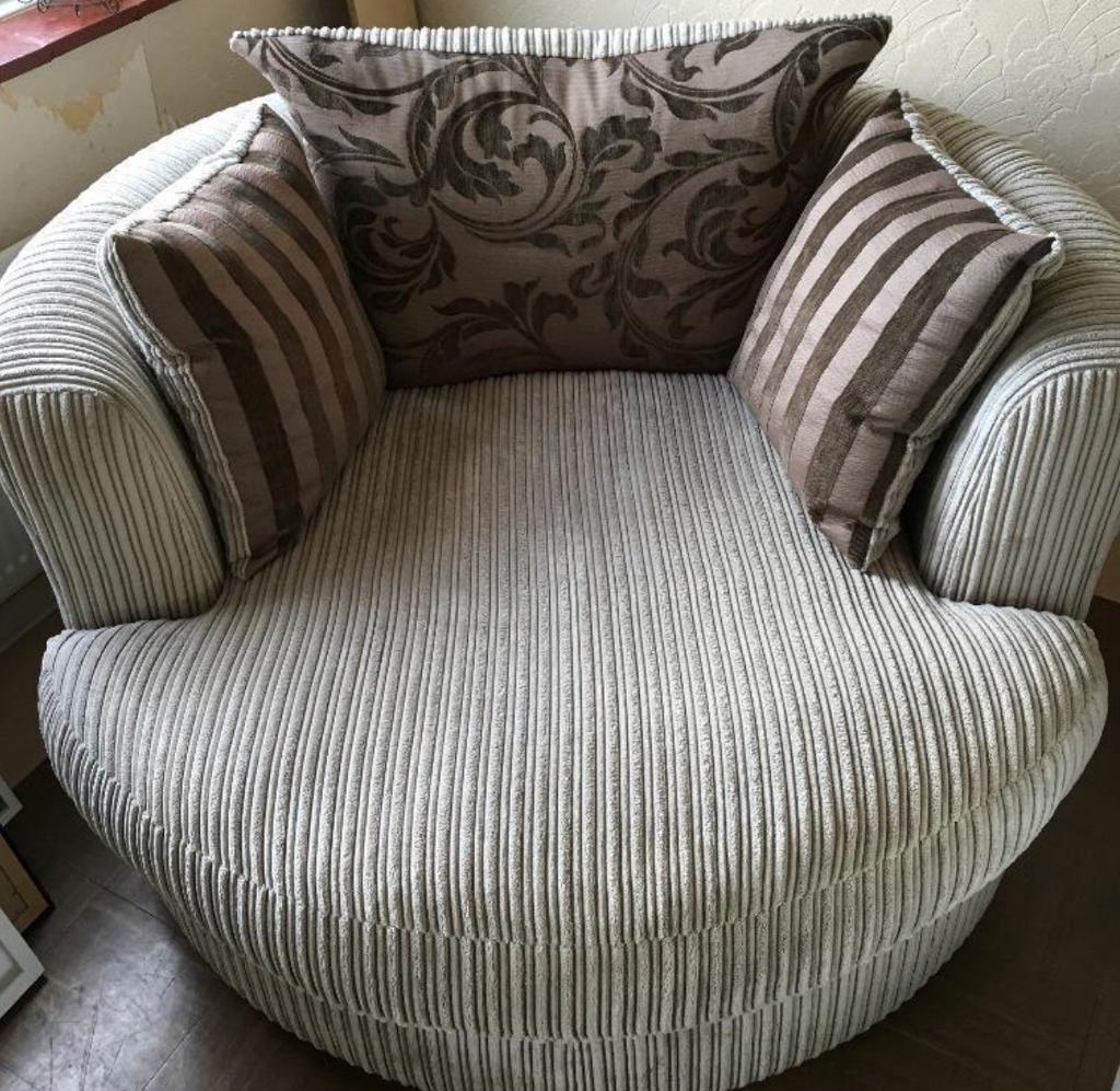 DFS Swivel / hugger chair. Grey/mink. Hardly used