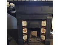 Antique Cast Iron Fireplace with Mantle and Tiled Inserts