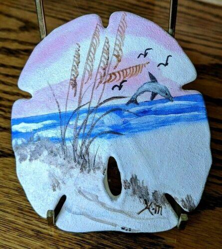 "Hand painted sand dollar, artist signed, beach scene, porpoise, grass, 4 1/8""h"