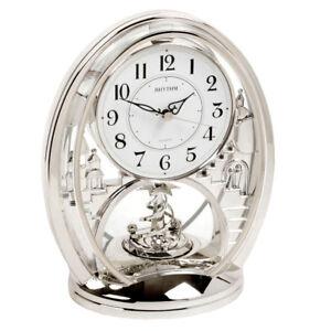 RHYTHM Contemporary Modern Mantel Clock Silver Rotating Spiral Moving Pendulum