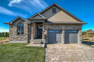 CUSTOMS HOMES IN STRATHROY BACKING ONTO GOLF COURSE