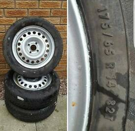 Three 14 inch steel wheels and tyres