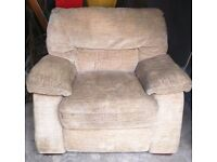 Beige fabric large comfy armchair