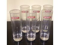 Six tall tumblers for vodka, branded 'Smirnoff'