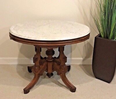 - Antique Victorian Walnut Marble Top Carved Oval Parlor Table