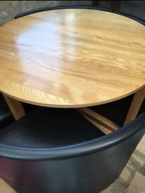 wooden dining table with brown leather chairs