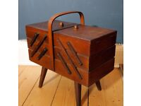 Vintage cantilevered wooden fold out sewing box with legs and carrying handle