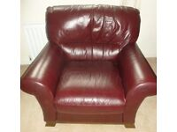 3 seater and 2 seater sofas and one matching chair in wine leather.