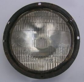 Military headlamp complete assembly with outer bezel as fitted to Military vehicles, Lucas 700 lens.