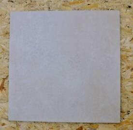 Large light stone floor tiles